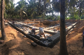 Talapady House: stones being laid for 90cm-wide strip foundations