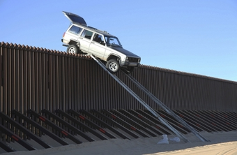 A Jeep Cherokee making an attempt to cross the wall near Yuma, Arizona in 2011, using a foldable ramp that was attached to the truck.