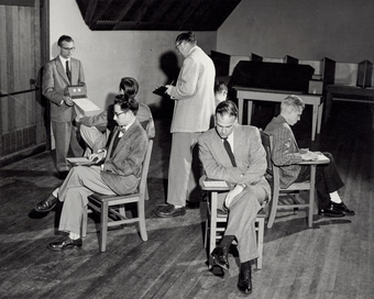 Members of IPAR are seen simulating one of the tests, known as the Bingo Test, which was a measure of group behavior.