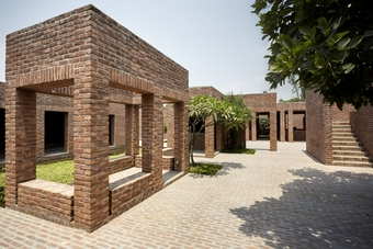The design relies on natural ventilation and cooling, being facilitated by courtyards and pools and the earth covering on roofs