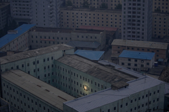 A picture of North Korean founder Kim Il Sung decorates a building in Pyongyang.