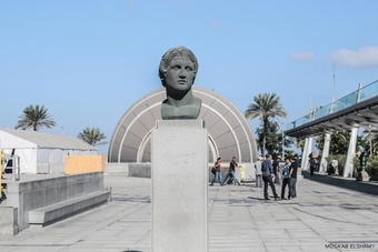 A bust of Alexander the Great, the founder of Alexandria city, is seen outside the Library of Alexandria as university students wait for the library to open on Sept. 14.