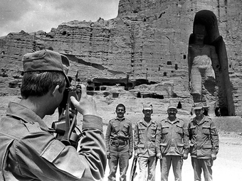 Soviet soldiers posing for a photograph with one of the Bamiyan Buddhas, during the Soviet-Afghan war, 1980s.