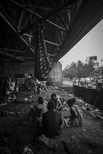Members of the community living under the Amar Mahal flyover