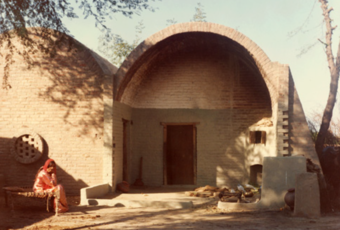 Openings shaded from sun by the overhang, or kept small and screened with brick djallis