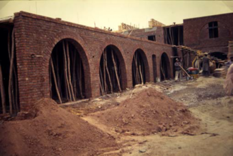 The language is of exposed brickwork, used explicitly to demonstrate the structure of the building and its utilitarian character. The source of this vocabulary can be most easily attributed to the surviving colonial buildings in the region.