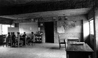 A meeting room on the second floor in the Moheshkhali shelter; the interior walls are exposed brick.