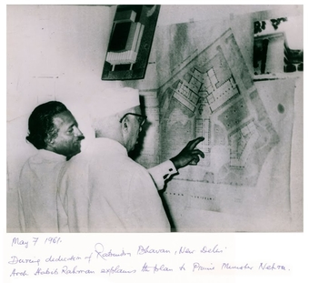Architect Habib Rahman explains the details of the plans of Rabindra Bhavan and the Lalit Kala Akademi buildings to Prime Minister Jawaharlal Nehru on May 7th 1961, New Delhi, India.