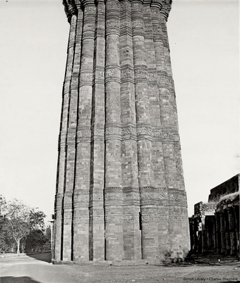 The Kutb Minar. Base of the Minar from the east and (above) view from the West