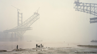 A Nadav Kander image from Chongqing, China, in 2007 captures change along the Yangtze.