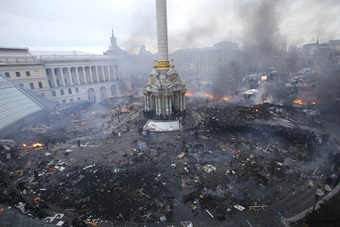An aerial view of Independence Square shows clashes between anti-government protesters and riot police in central Kiev.