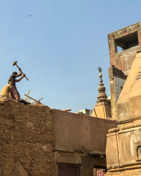 Workers demolish buildings in Varanasi's Lahori Tula neighborhood as part of a multimillion-dollar refurbishment project. Hundreds of thousands of pilgrims come to Varanasi every year.