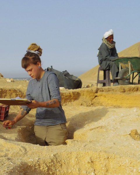 Excavating waist-deep graves at the North Tombs Cemetery.