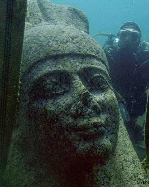 The head of a colossal red granite statue of the god Hapi that decorated the temple of Thonis-Heracleion is lifted from the sea bed.