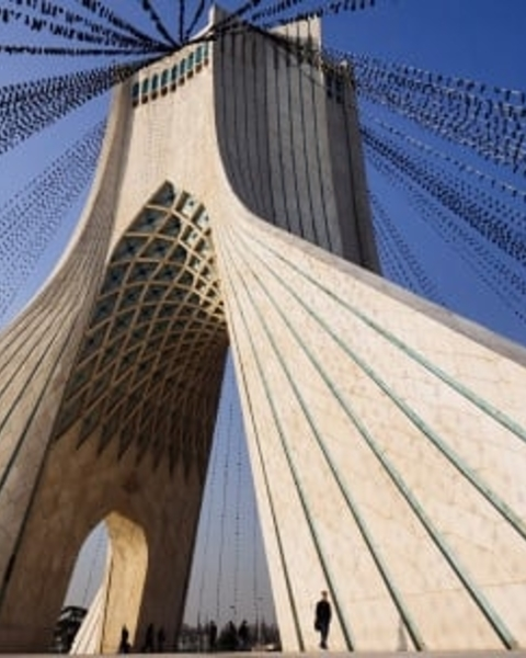 The Azadi tower in Tehran is strung with black flags
