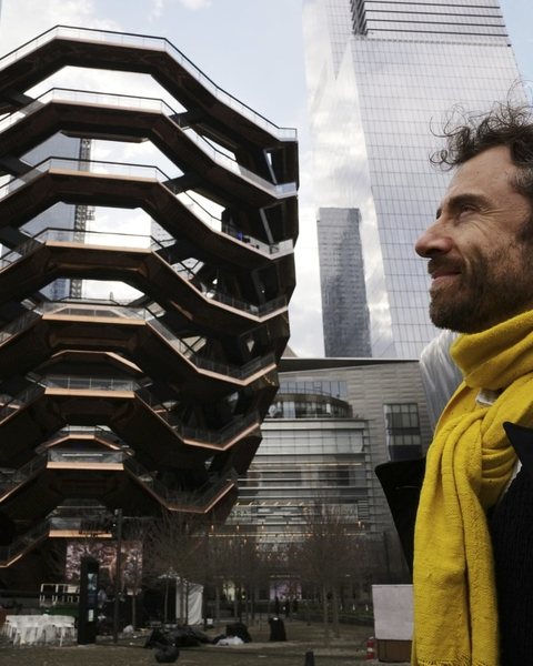 Thomas Heatherwick posing next to Vessel at Hudson Yards.