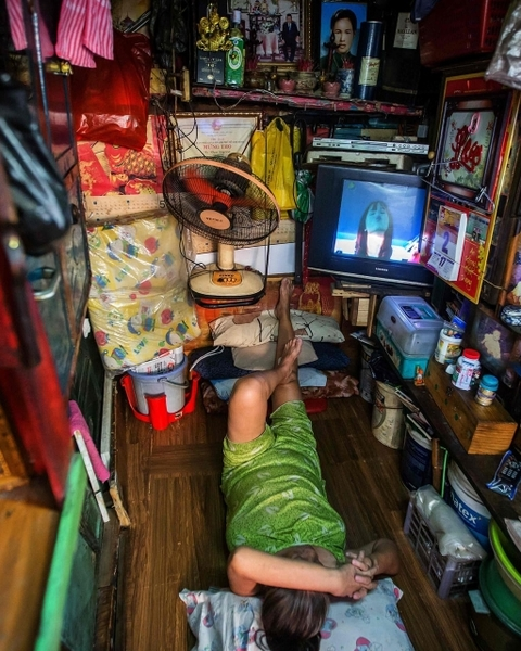 Kha Tu Ngoc watches television at home