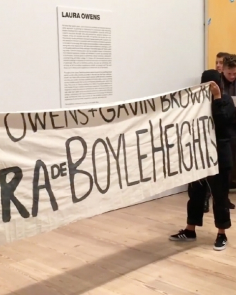 Members of Boyle Heights Alliance Against Artwashing and Displacement (BHAAAD) protest at the Whitney Museum during Laura Owens's opening on Wednesday, November 8