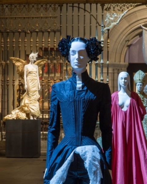 Installation view of Heavenly Bodies: Fashion and the Catholic Imagination in the Medieval Sculpture Hall