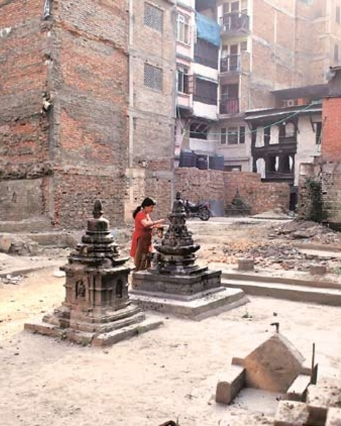 A woman prays at a collapsed temple in Kathmandu on Monday, 25th April, 2016