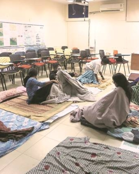 Ever since a room in the hostel caught fire, the 200 girls living there have refused to go back. Some of them have been living in the studio at the college building.