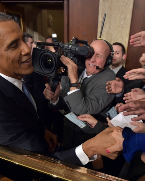 President Barack Obama shakes hands after delivering the State of the Union address before a joint session of Congress on Tuesday, Jan. 20, 2015, on Capitol Hill in Washington