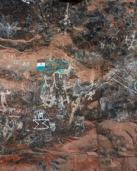 Heritage vandalised: Some rock paintings at Karikiyoor have been covered with graffiti and defaced