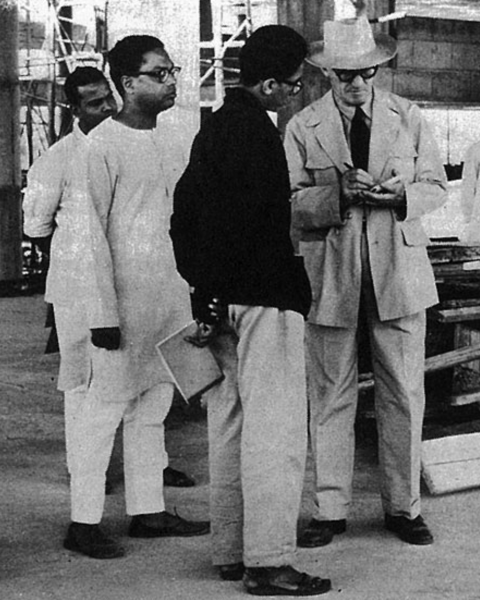 A youthful Doshi (in black coat) on site with Le Corbusier.