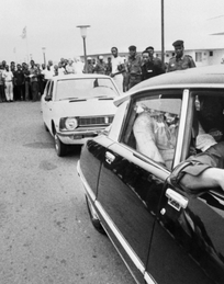 Crowds line the streets of Kinshasa as Muhammad Ali passes ahead of his 30 October 1974 heavyweight fight against world champion George Foreman.
