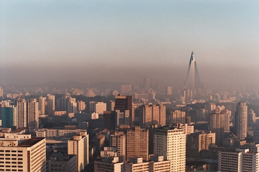An aerial view of Pyongyang, with the Ryugyong Hotel rising in the background.