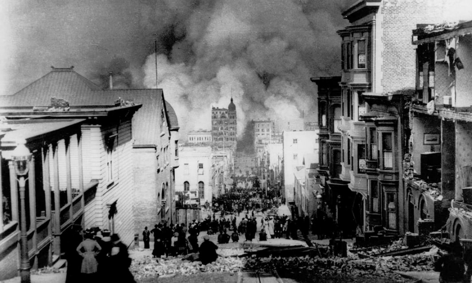 People on Sacramento street watch smoke rise from fires after an 8.3 earthquake hit in San Francisco, 1906.