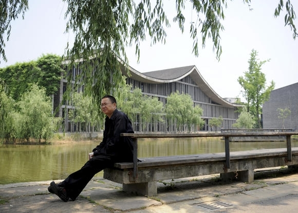 Wang sits outside one of his buildings at the China Academy of Art in Hangzhou.