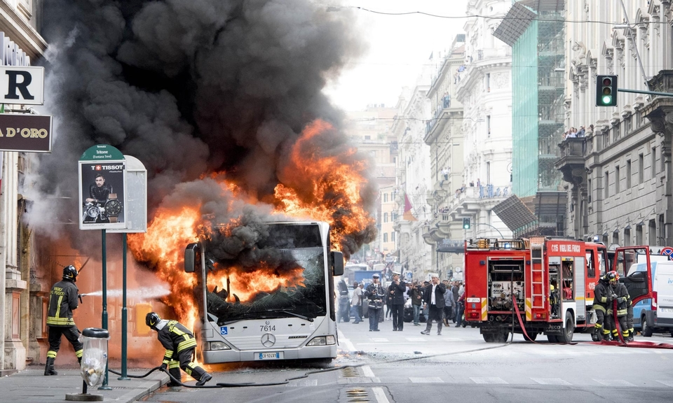A bus in Rome is engulfed by flames in May 2018.