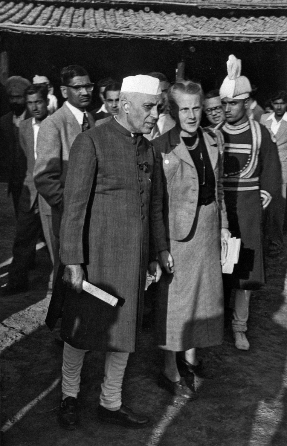 "Seminar and Exhibition on Low-Cost Housing and Community: H.E. Mr. Jawaharlal Nehru, Prime Minister of India as he visited the ""model village"", with U.N. technical assistance expert, Miss Jacqueline Tyrwhitt, who directed the Seminar at New Dehli, India"