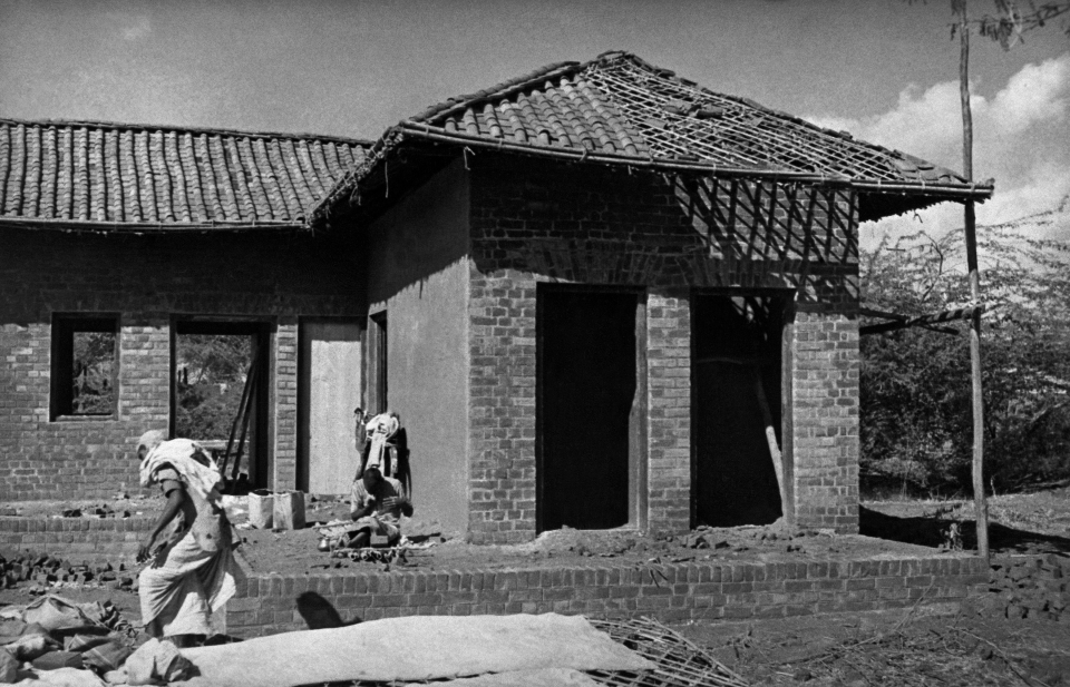 Seminar and Exhibition on Low-Cost Housing and Community Improvement: This photograph, taken before the Exhibition opened, shows the village health clinic under construction