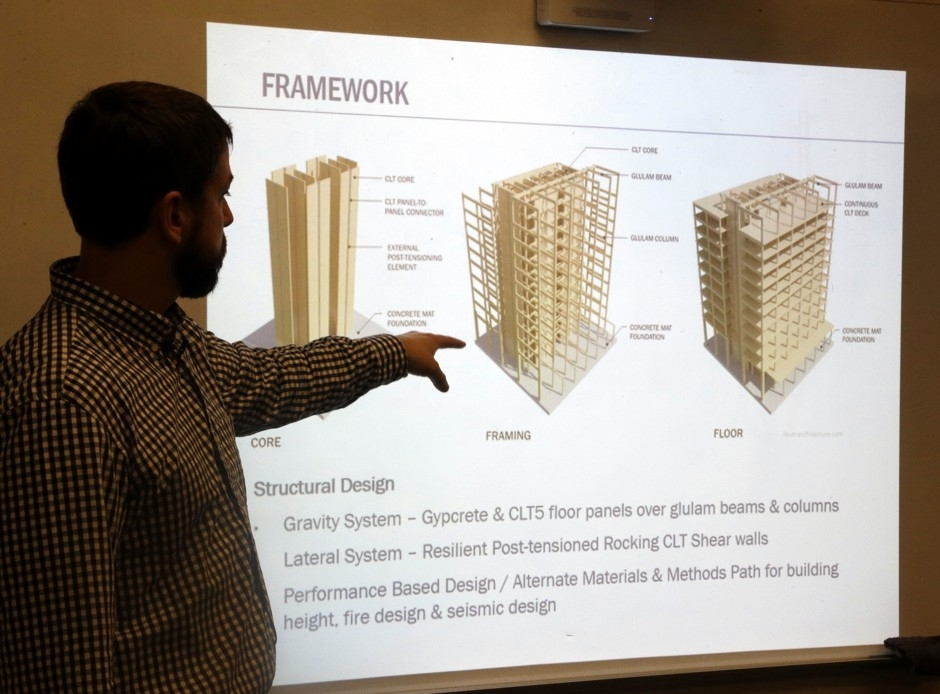 Structural engineer Eric McDonnell shows diagrams of high-rise construction using cross-laminated timber at Portland State University in 2016.