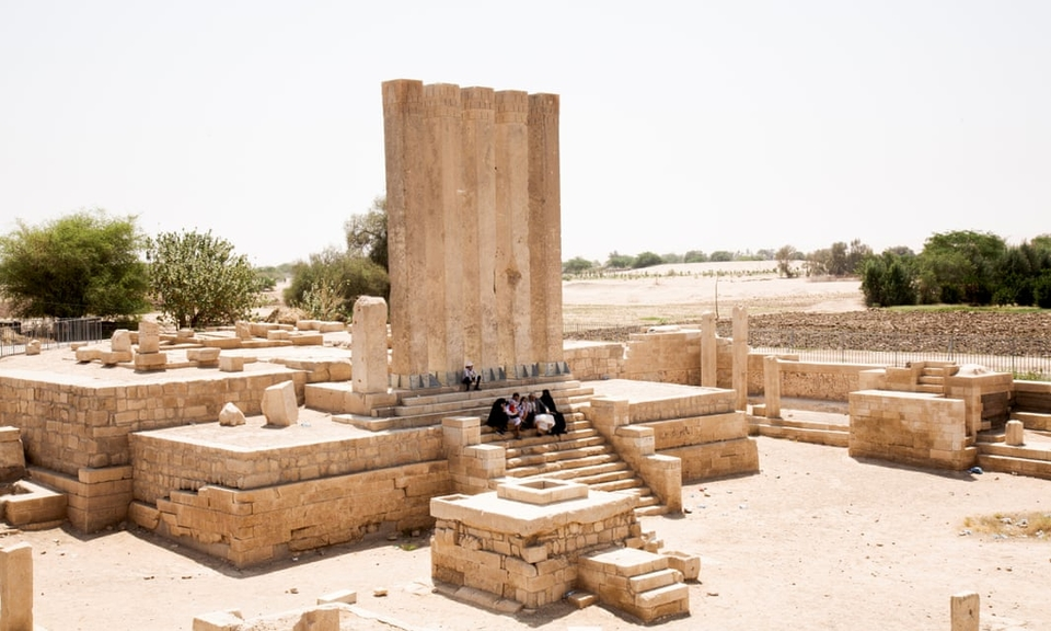 A family sits in the ruins of the Barran Temple – reputed to be the location of the Queen of Sheba's throne – near Marib in September 2019.