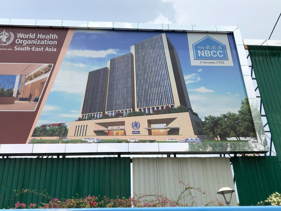 A hoarding showing the new 'development scheme' that will replace Rahman's WHO building in New Delhi