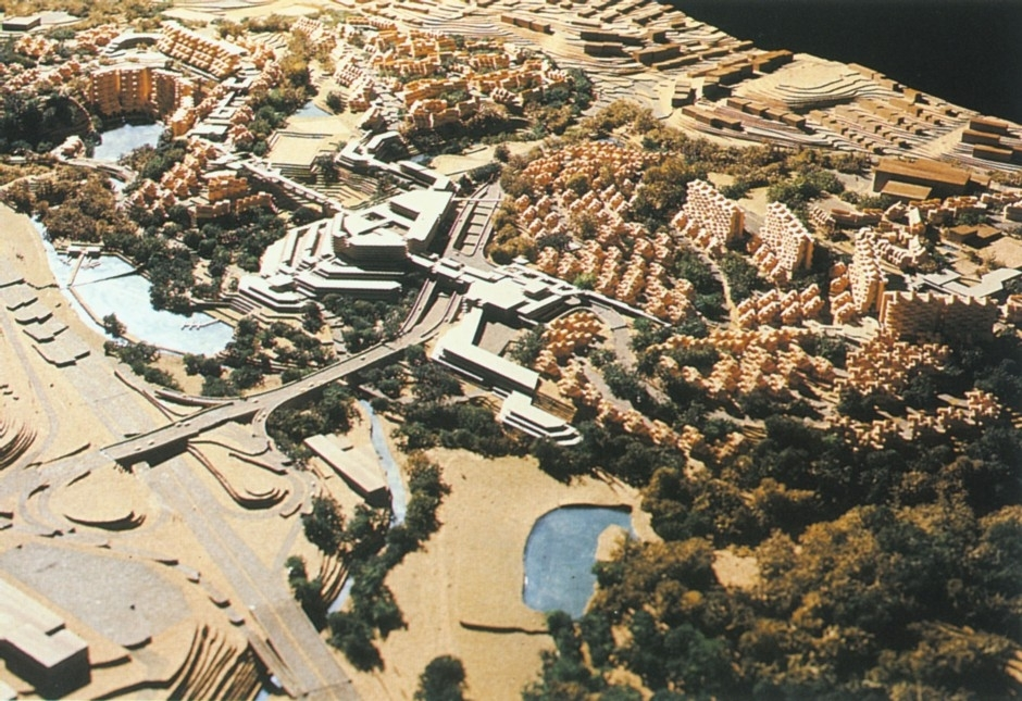"Safdie's idea was to create a ""crescent of housing in a horseshoe shape"" that would ring the quarry. Access would be from the upper portion of the building, with much of the structure's height descending the sides of the quarry."