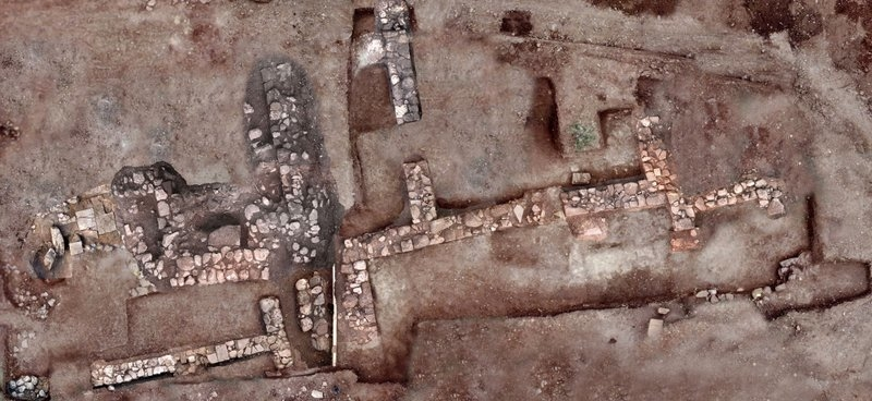 This undated photo provided by the Greek Ministry of Culture on Tuesday, Nov. 13, 2018, shows remains of walls and floors, probably from houses, from the lost ancient city of Tenea.