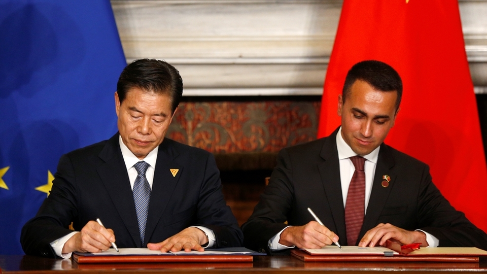 Di Maio, right, and Chinese Commerce Minister Zhong Shan sign some of the 29 accords