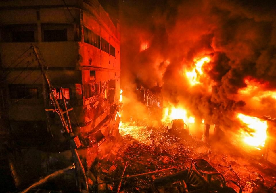 Flames rise from a fire in a densely packed shopping area in Dhaka, Bangladesh, Thursday, Feb. 21, 2019. A devastating fire raced through at least five buildings in an old part of Bangladesh's capital and killed scores of people.