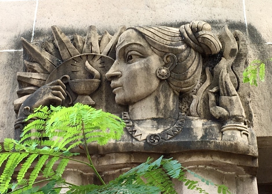 Relief with a traditional Indian face and Indian symbolism, on the New India Assurance building