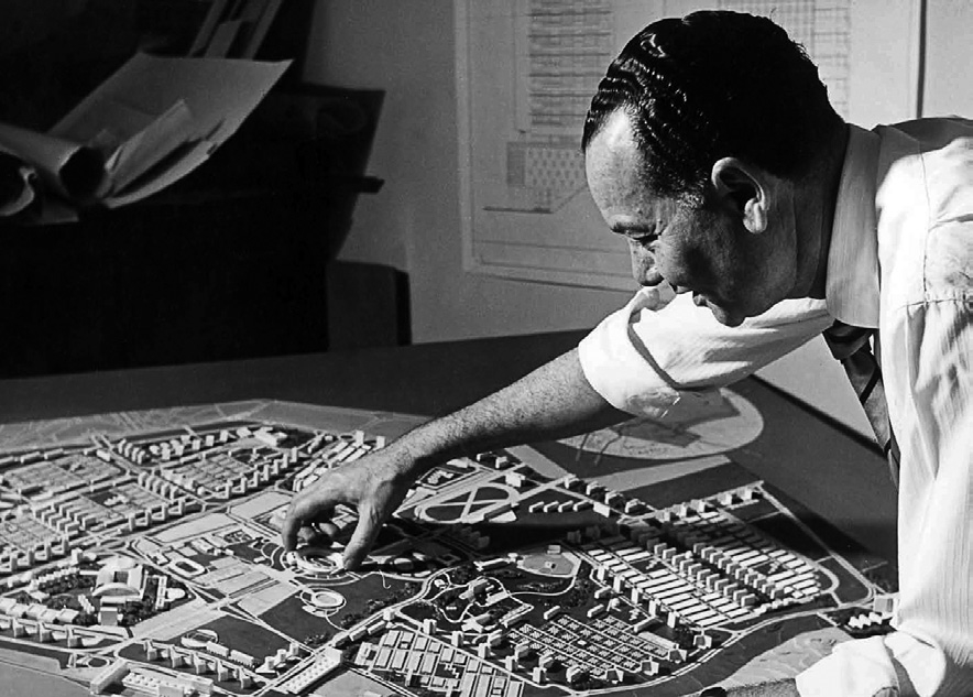 The architect Sayed Karim stands over a scale model of Nasr City, his plan for an urban expansion of Cairo in the 1950s