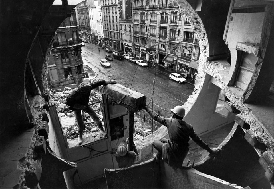 """Gordon Matta-Clark and Gerry Hovagimyan working on """"Conical Intersect,"""" 1975"""