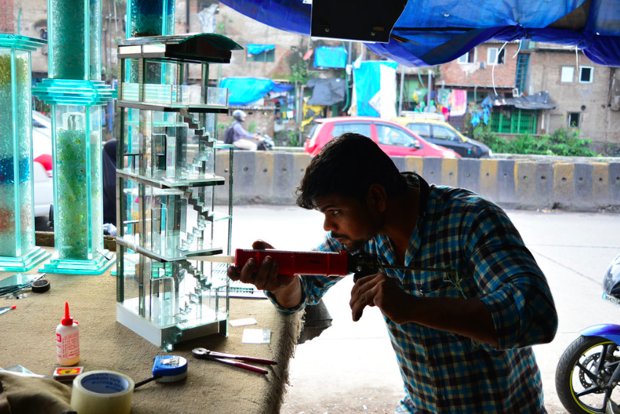 A craftsman in Dharavi completing a model for the Ideal Home, Dharavi Contractor project.