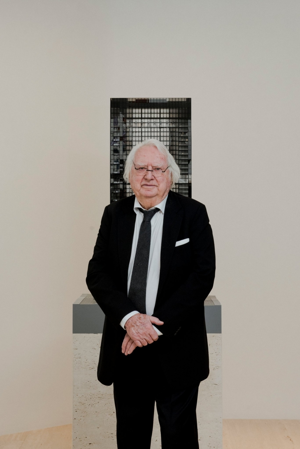 The architect Richard Meier posing earlier this month with a model for a residential tower in Manhattan