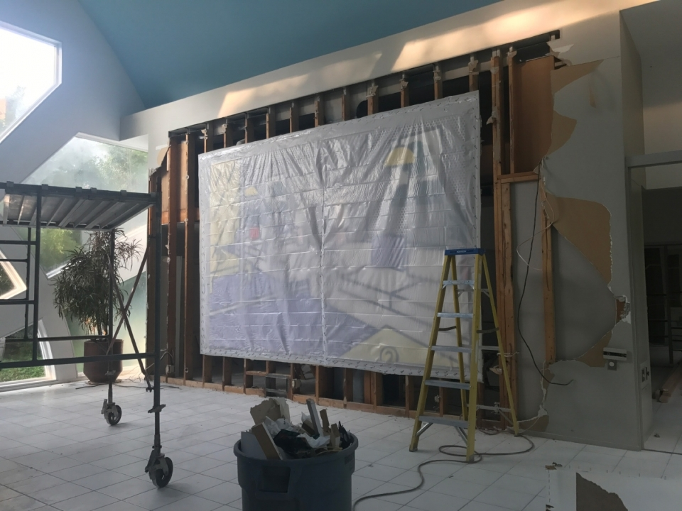 The Roy Lichtenstein painting in the living room has been covered ahead of its removal