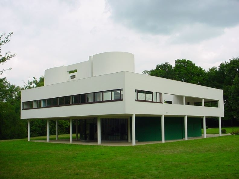 View of the west and south facades of Villa Savoye, designed by Le Corbusier and Pierre Jeanneret, and built between 1928 and 1931.