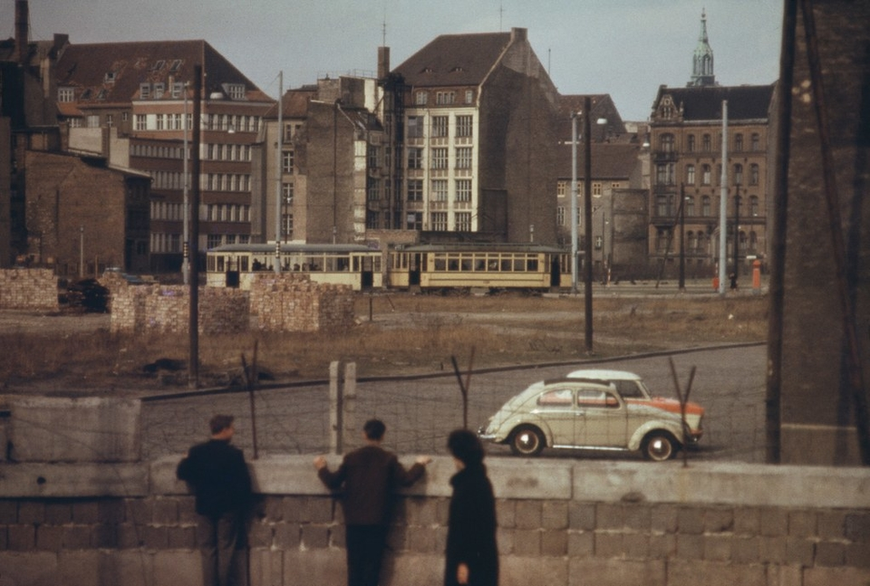 West Germans look over the Berlin Wall, around 1970. As new security barriers multiply around the world, research is revealing their psychological toll.